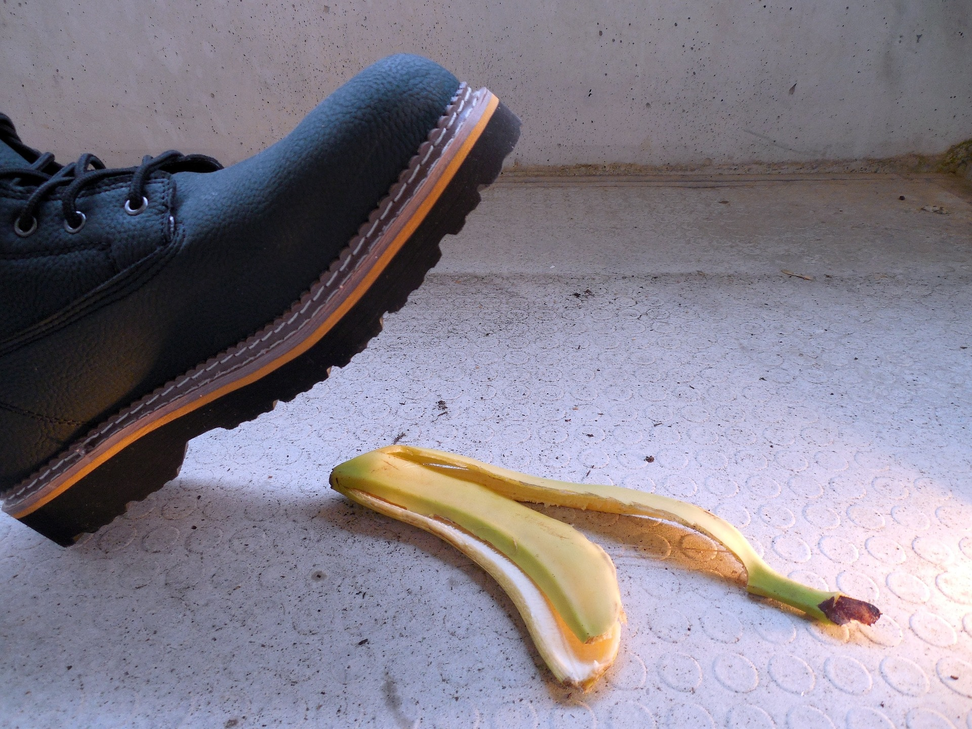 work boot about to step on banana peel