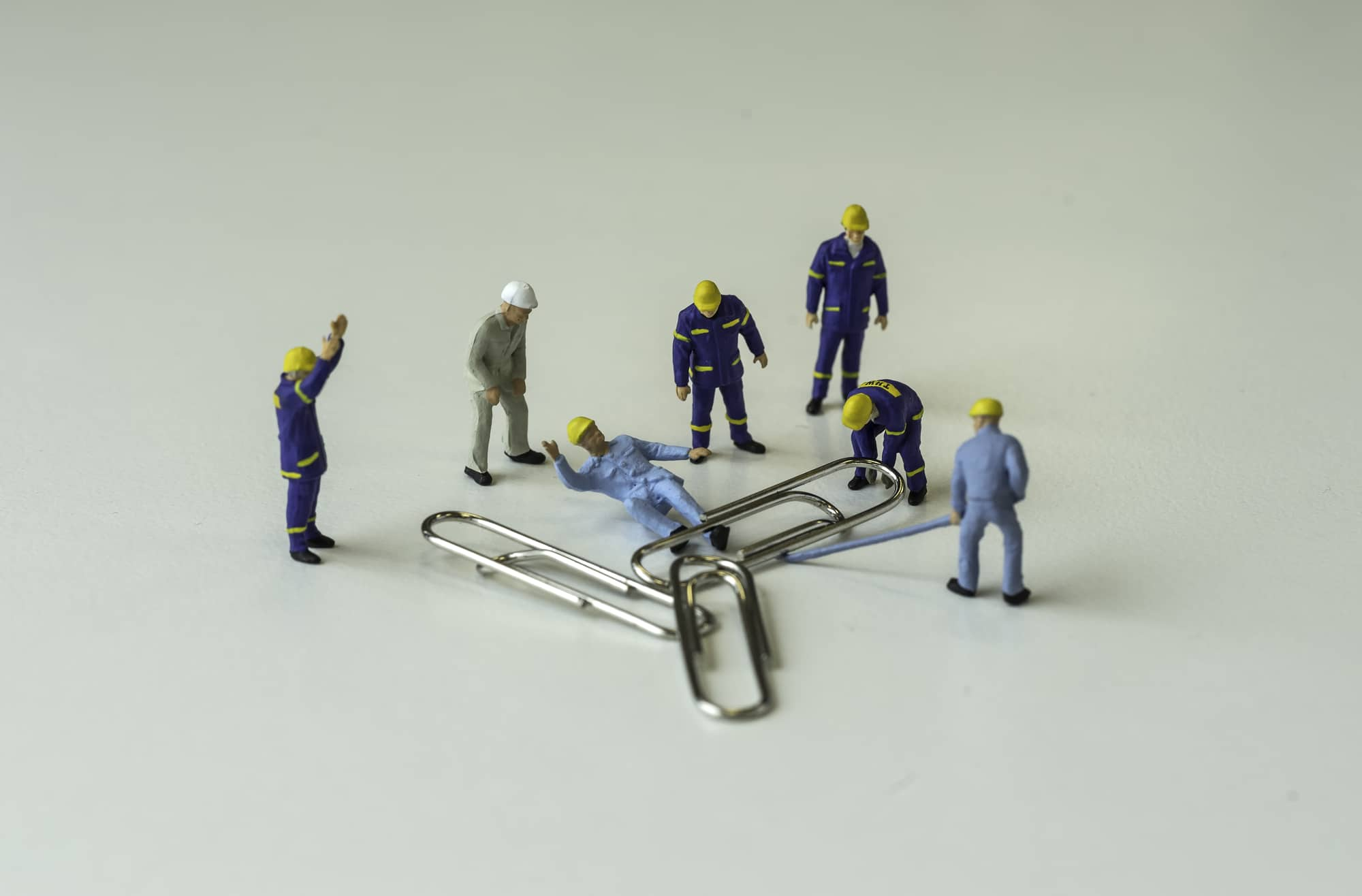small figures witnessing workplace accident