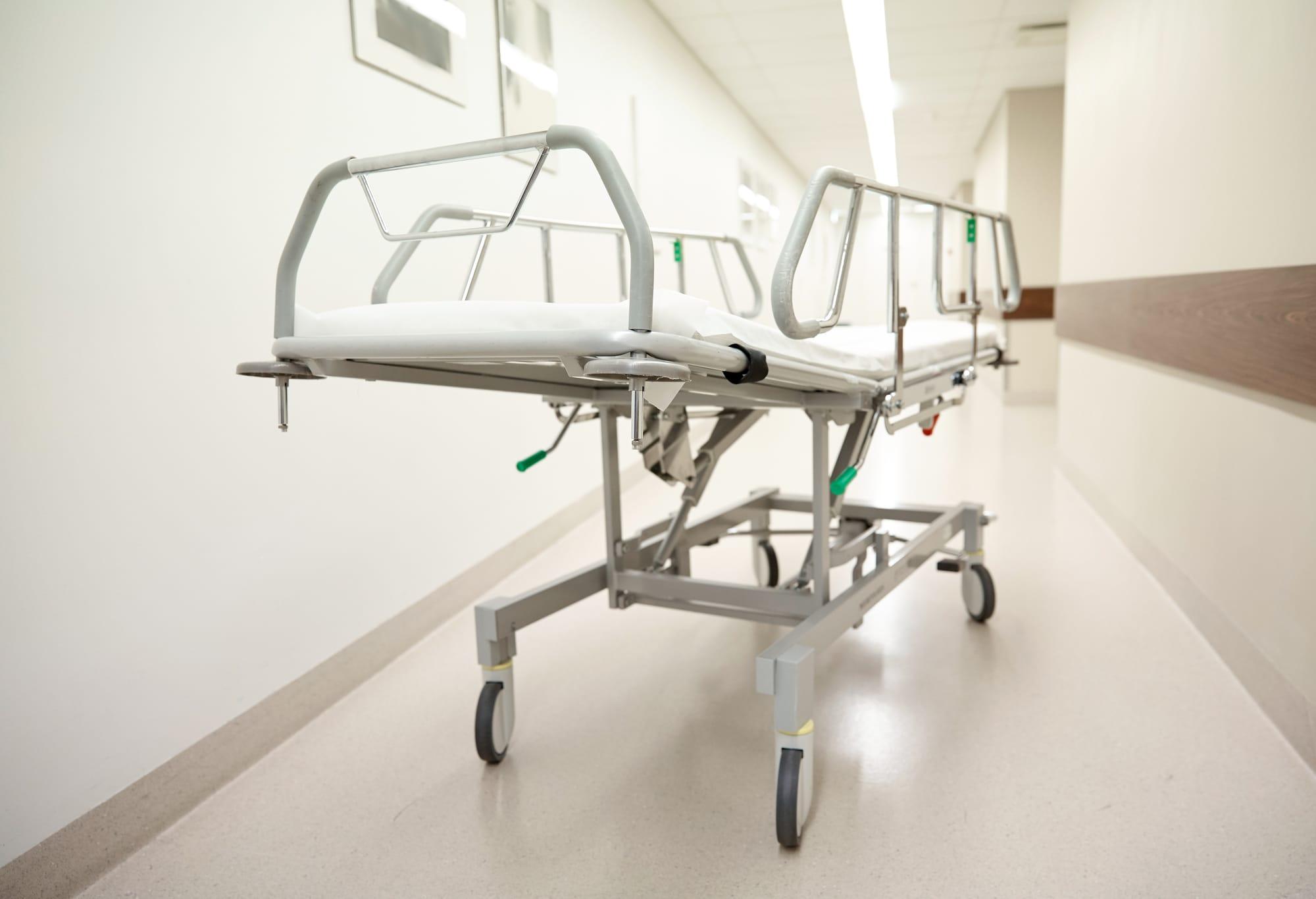 empty gurney in hospital corridor