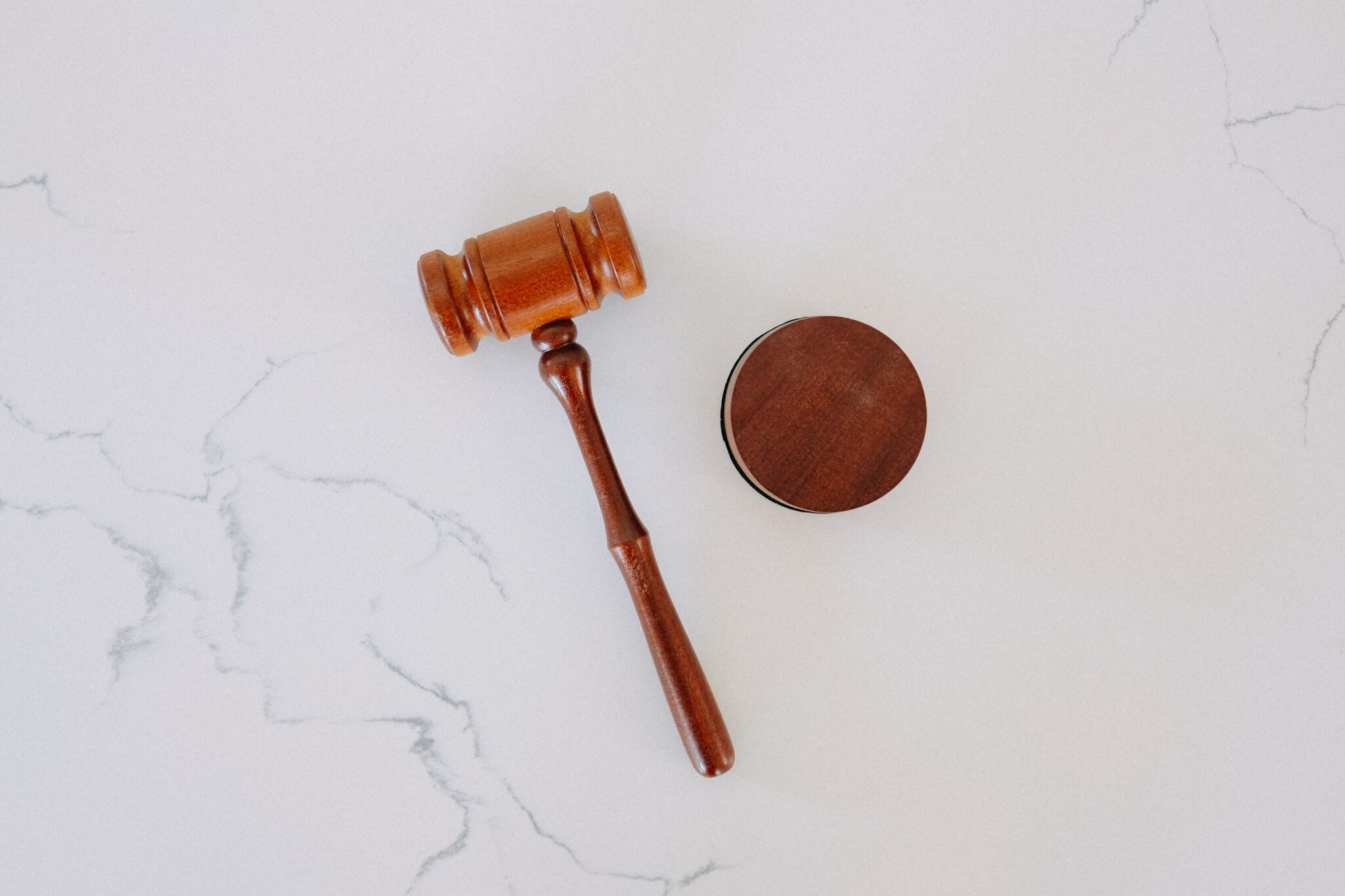 Judge's gavel on marble surface
