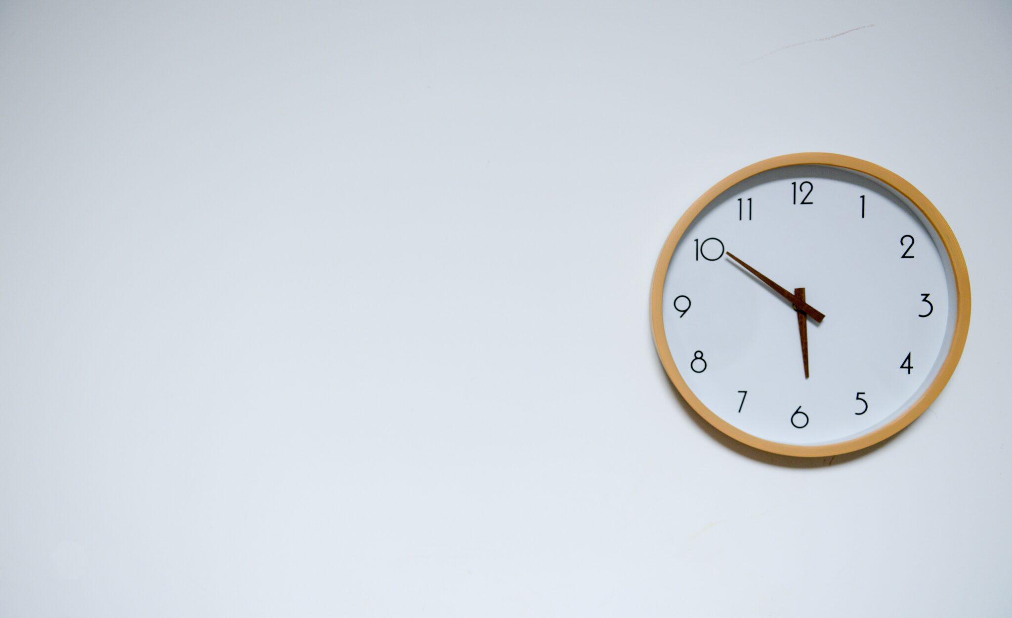Minimal clock on white wall