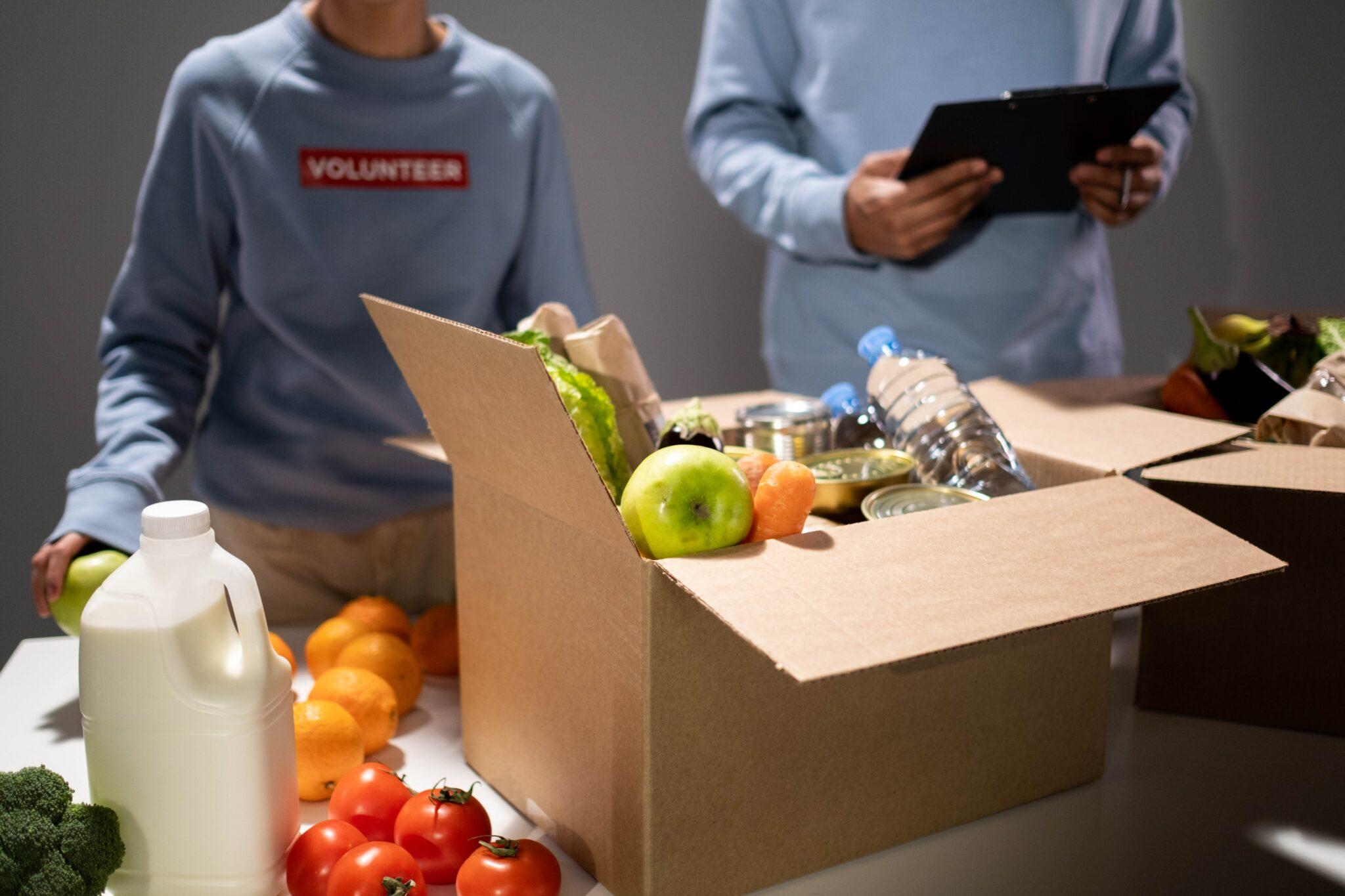 volunteers packing a food box